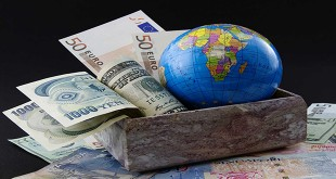 Globe with world currencies in marble box and placed on world currency
